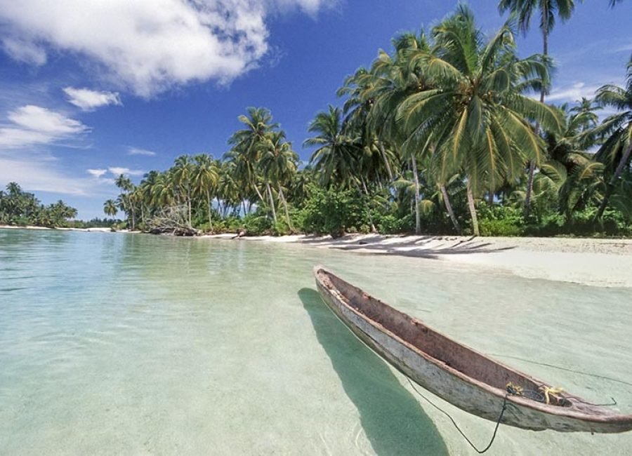 Indonesia, West Sumatra Province, Mentawai islands, traditional canoe on beach. The Mentawai Islands are a chain of about seventy islands and islets off the western coast of Sumatra in Indonesia.